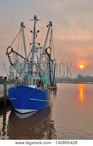 Crab Fishing Trawler in Harbor of Greetsiel at german North Sea,wadden Sea,Lower Saxony,Germany