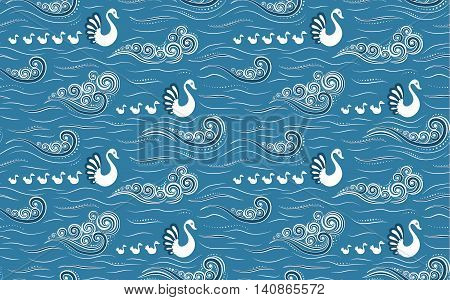 Swans with cygnets in blue lake or sea with waves