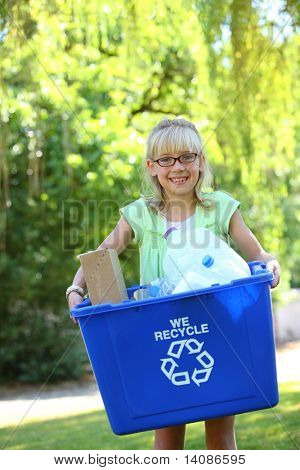 Young girl with recycle bin