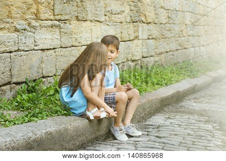 Small friendly kids on street