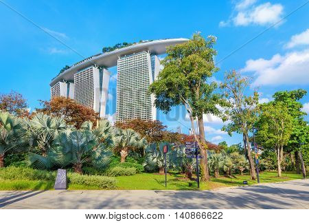 Singapore, Republic of Singapore - May 4, 2016: Gardens by the Bay with Marina Bay Sands hotel on background