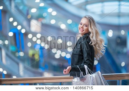 Smiling beautiful girl in a store