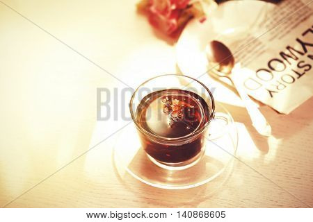 Cup of tea with flowers on table