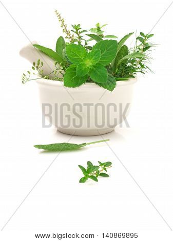 Alternative health care fresh herbal and Bottle of aromatherapy in mortar on white background.