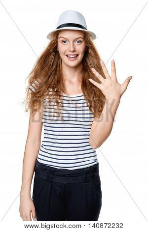Hand counting - five fingers. Happy excited summer woman in straw fedora hat showing five fingers