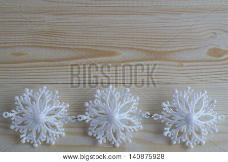 Snowflakes border on wooden background.Christmas and New Year Decoration, flat lay