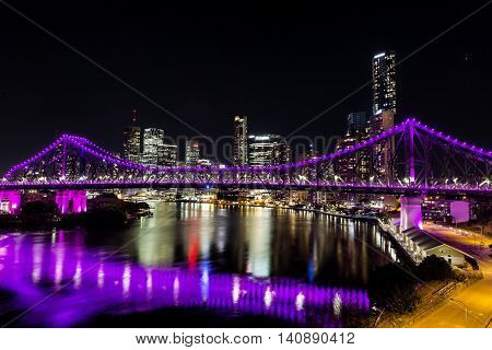 BRISBANE, AUSTRALIA: Story Bridge and cityscape by Night - magenta lights