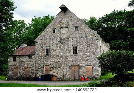 Lititz Pennsylvania - June 7 2015: Late 18th century stone manufacturing mill with shingled roof and small dormers on Market Street