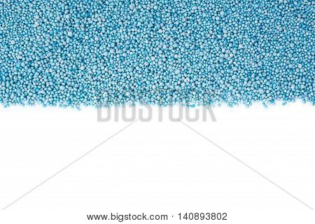 Top View Of Pattern Blue Urea Fertilizer Isolated On White