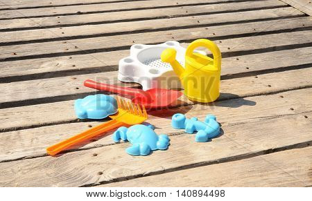 Toys set on a wooden pier outdoor shoot