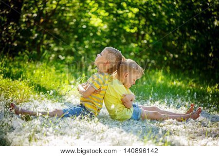 Two little boys friends resentful kids in summer day . Concept of friendship