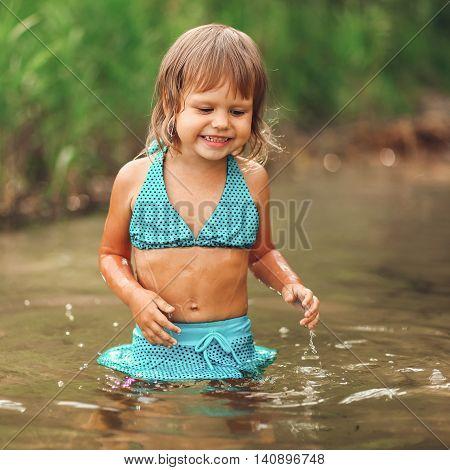Child Swim In Lake.