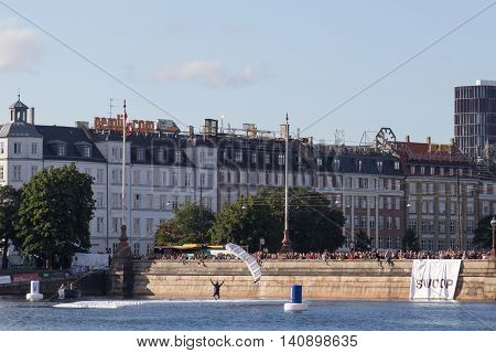 Copenhagen, Denmark - July 30, 2016: A skydiver celebration his landing on a pontoon at the Copenhagen Swoop Challenge