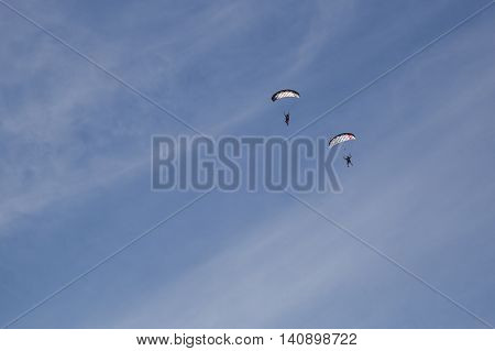 Copenhagen, Denmark - July 30, 2016: Two skydivers just before landing in a lake at the Copenhagen Swoop Challenge.