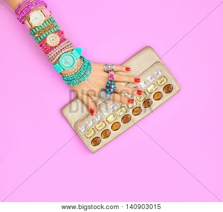 Fashion. Clothes Accessories fashion Set. Female hand Stylish Trendy Handbag clutch, Glamor Wrist Watches. Summer fashion girl Outfit, Luxury Party accessories.Hipster Essentials.Minimal fashion style