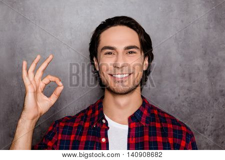 Happy Young Man With  White Smile Showing Sign Ok