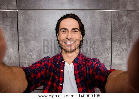 Joyfull Young Man Makes Selfie Photo And Smiling