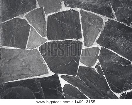 Black stone wall in resort. Nature background.