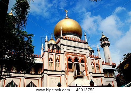Singapore - December 17 2007: The 1924-28 Masjid Sultan Singapura Mosque with its great gilded onion dome in the historic Kampong Glam Arab district