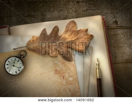 Vintage writing paper with pen on wood