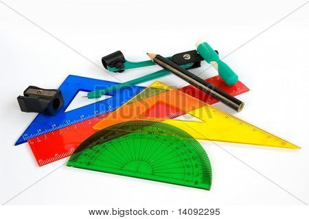 Pen, ruler and setsquare on white background
