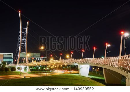 Night view of the street and the cable-stayed bridge in Poznan