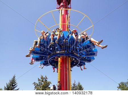 ALMATY KAZAKHSTAN - AUGUST 2 2016: The Fantasy Amusement park located in Almaty Kazakhstan. People ride and get the adrenaline.