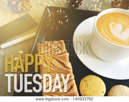 Happy Tuesday word on coffee with dessert background