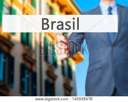 Brasil - Businessman Hand Holding Sign