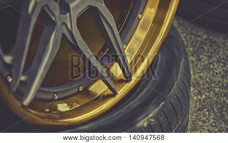 Closeup Detail Of Gold Aluminum Car Wheel