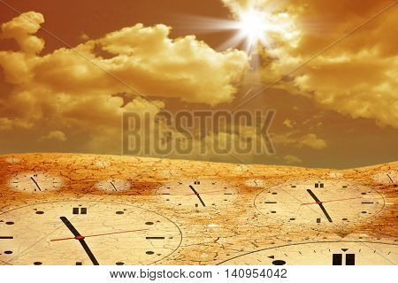 conceptual image of dried and cracked landscape and clock over dramatic sky.