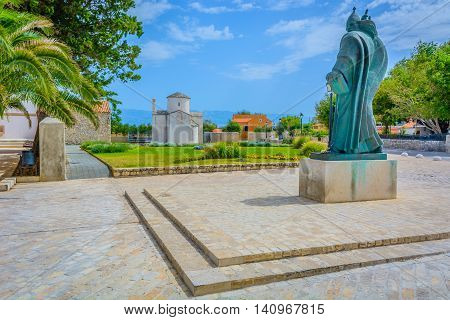In Nin town is located smallest cathedral in the world called Church of The Holy Cross with statue of Grgur Ninski in foreground, Croatia.