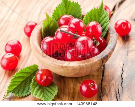 Nanking or felted cherry ftuits with leaves on the wooden table.