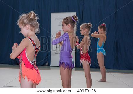 Warsaw Poland - June 25 2016:  A group of girls begin their art gymnastics performance