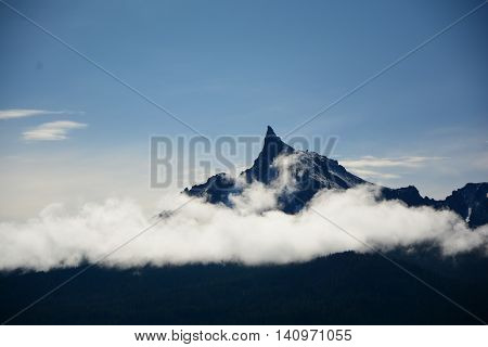 MT Thielsen Oregon above the clouds sharp peak