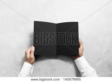 Hand opening blank black brochure booklet mockup. Leaflet presentation. Pamphlet mock up holding hand. Man show clear offset paper. Booklet design template. A5 paper sheet display read first person
