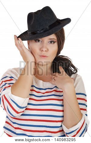 buxomy serious girl with a hat on a white background