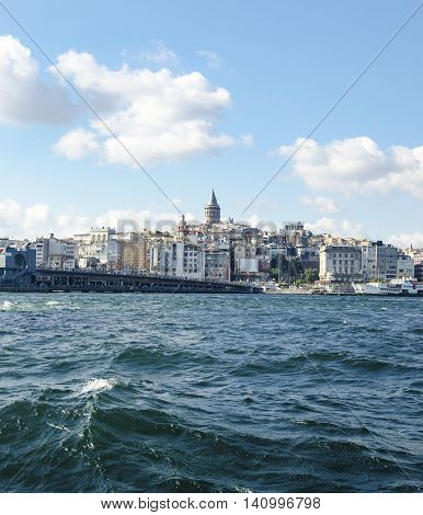 Istanbul Turkey. Galata Bridge and Galata Tower in the background Istanbul views. This is a great place to see the colors of Istanbul at . Interesting to see the fishermen on the bridge with the Galata tower in the background. There are lots of restaurant