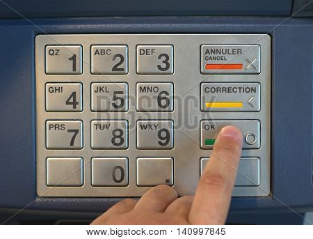 entering nip code numbers in cash machine by pressing buttons