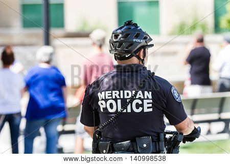 MERIDIAN IDAHO/USA - JULY 30 2016: Member of the meridian police department watches the pro police rally in Meridian Idaho
