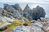 rocky coastal scenery around Pointe de Pen-Hir in Brittany France poster