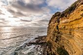 Cliffside erosion with ocean background at Sunset Cliffs in San Diego, California. poster