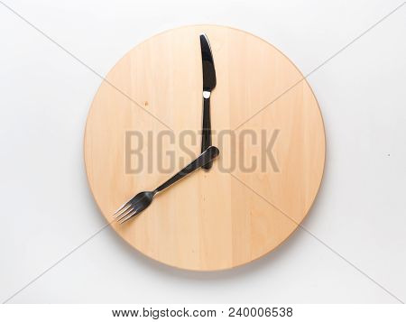 Intermittent Fasting And Skip Breakfast Concept - Empty Wooden Round Tray Or Trencher With Cutlery A