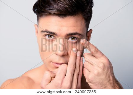 Concept Of Clear Vision Correction With Contact Lenses. Close Up Portrait Of Handsome Young Man Hold