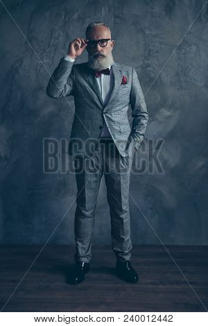 Full Length Portrait Of Attractive, Serious Millionaire In Jacket, Holding Hand In Pocket, Eyelet Of