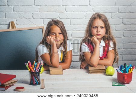 Back To School And Home Schooling. Bored School Kids At Lesson In September 1. School Time Of Girls.