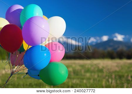 Multicolored Balloons Outdoor Festival On Blue Sky Background