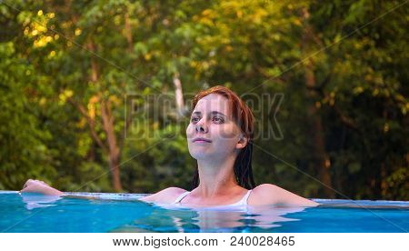 Dreaming Woman In Open Swimming Pool. Girl In Open Swimming Pool. Summer Vacation Experience Photo.