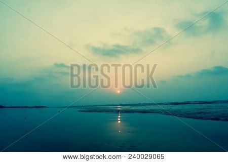 Vivid Blue Sunrise On A Serene Calm Tranquil Deserted Beach With Space For Text At Digha Puri Mandar