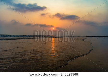 Vivid Sunrise On A Serene Calm Tranquil Deserted Beach At Digha Puri Mandarmaniwith Space For Text